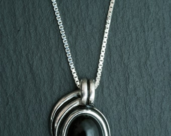 Handmade silver pendant with onyx and black  enamel