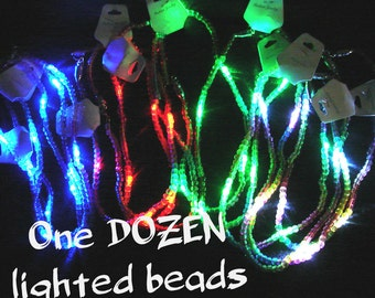 One DOZEN LED Mardi Gras Beads!  Flashing necklace with colored LEDs and rainbow beads. Great to giveaway or use as a Mardi Gras throw!
