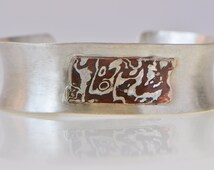 Silver and copper mokume gane anticlastic cuff bracelet