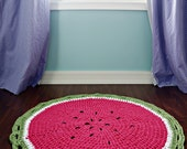 The Watermelon nursery area rug