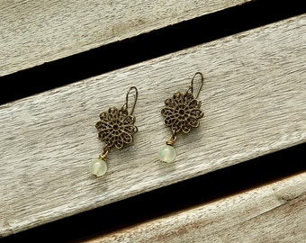 Brass earrings with filigree flower and gem stones, pale green dangle earrings