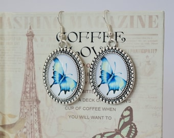 Earrings with pendants with blue butterfly