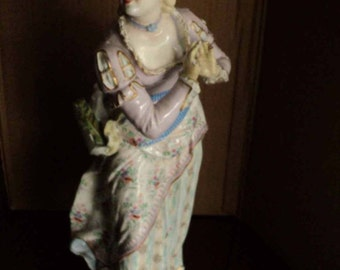 Antique porcelain statue