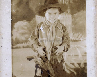 1950s Vintage Photograph of an Analog RPG. The Grinning Cowboy Kid