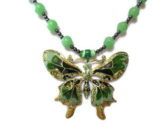green butterfly necklace, gold tone trim. green rhinestones, green glass stones, hematites, statement necklace, hand made artisan crafted