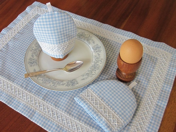 Australian cross stitch embroidery egg cosy and table by for Table mats design your own