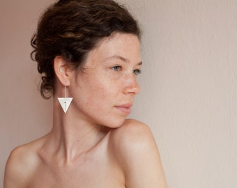 Long triangle earrings in sterling silver with hand sawed geometric pattern. Stylish and tribal!
