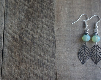 Earrings with silver leaf and beautiful bright light green beading