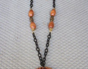 Intricate Floral Oblong Wood Pendant with Matching Beads on Black Fiber Chain