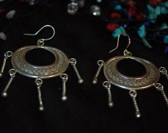 Large woven hoop and twist earrings
