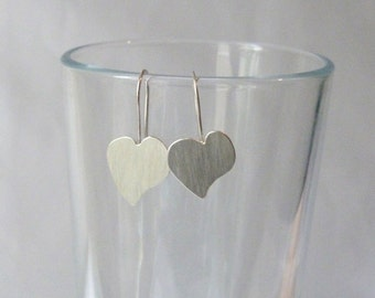 Sterling Silver lightly textured brushed Static Heart earrings.