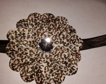 brown elastic headband with leopard flower