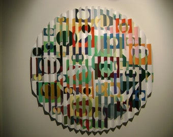 3-d kinetic wall sculpture made of paper and wood,titled maga 1