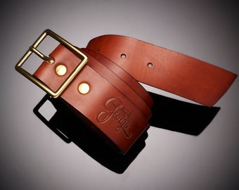 Brown leather belt buckle notch Design by George •