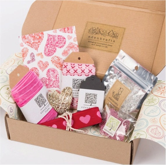 A curated + themed craft box of unique and high quality craft supplies - velvet ribbon, heart beads and embellishment, pendant, kraft tags