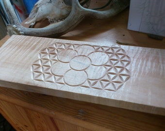 wood carving using sacred geometry seed of life created using traditional swiss technique