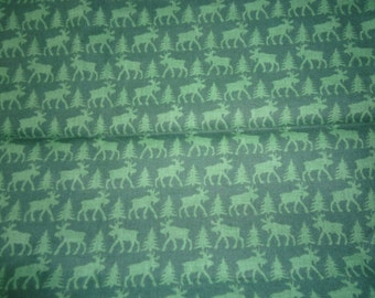 Deer and Tree dark green fabric 100 % cotton that is 18 inches plus 26 by 25 inchesneat winter fabric