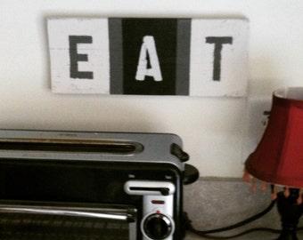 Eat sign in black