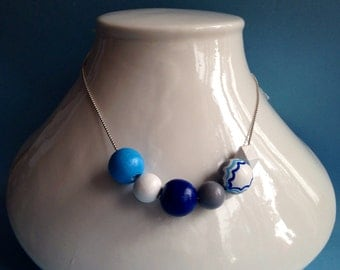 Silver necklace adorned with painted wood round beads.