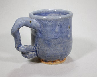 Light blue stoneware mug with funky handle.
