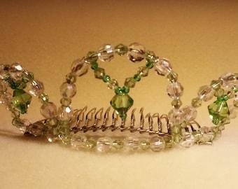 A small pale green tiara. Jade