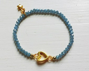 Bracelet with gold connector and beg