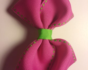 solid color very cute bows either pink, blue, and purple bow