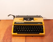 Vintage yellow Sperry Remington Tenfifty typewriter