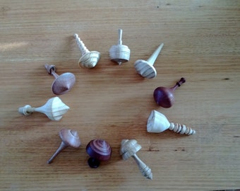 Wooden spinning tops- prices vary!
