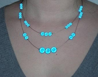 4. Short, blue Tigertail necklace