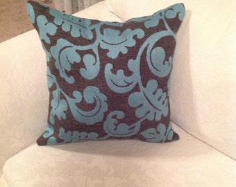 Teal and charcoal cushion