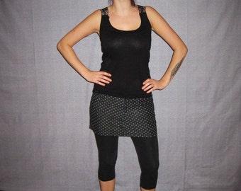 black jeans mini-skirt with white polka dots