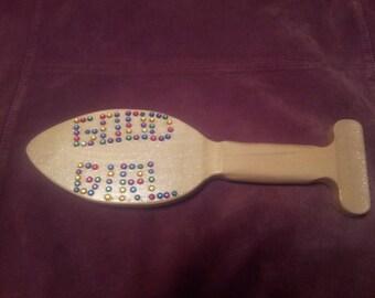 Butt plug jeweled paddle.