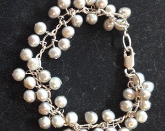 Slerling silver and fresh water pearl bracelet.