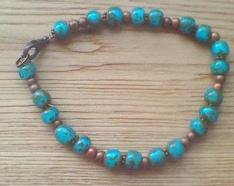 Picasso Czech Glass petrol blue metallic shimmer bead bracelet with bronze colour beads