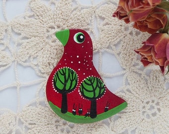Red ceramic brooch bird with bunnies