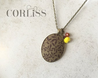 Floral fabric pendant necklace - with pops of color accent beads - brown leaf tonal flower print, antique bronze / brass necklace