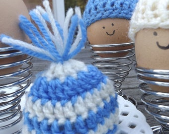 Crochet egg cosies. Set of three blue and cream coloured egg cosies. Egg warmers.