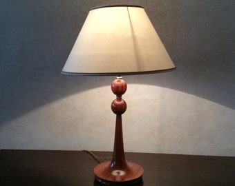Wooden base, hand turned and hand polished, for a table lamp. It is sold without lampshade.