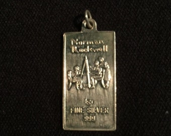 Norman Rockwell 1g .999 fine silver pendant