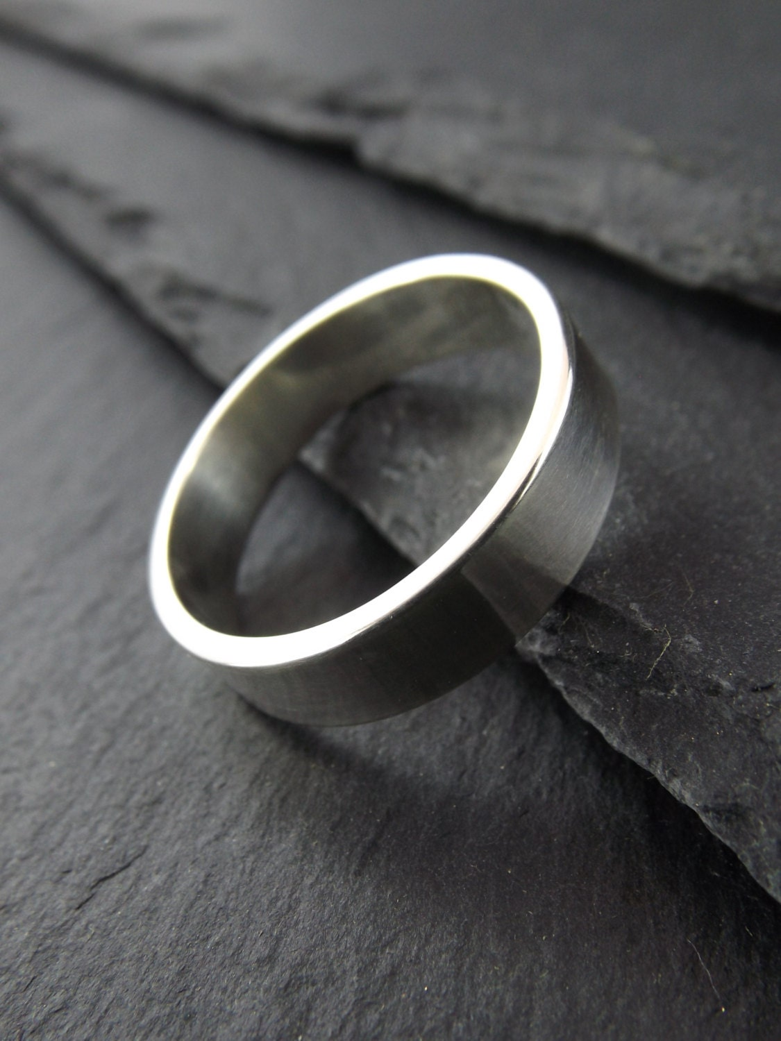 thick sterling silver ring with a polished finish mens