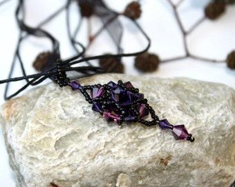 Oriental style purple and violet Swarovski crystals pendant