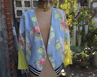 light bomber and floral print. Ultra modern. Neon yellow inserts. TG 42