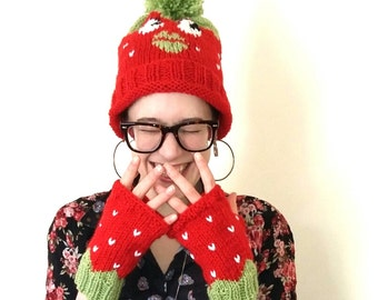 Strawberry hat. Hand knitted red and green strawberry bobble hat
