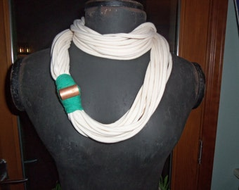 cream t-shirt infinity scarf with a copper pipe