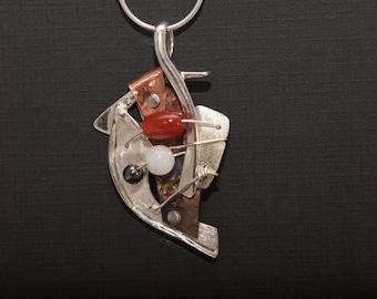 Sterling silver artisian pendant carnelian hematite quartz asymetrical hand crafted.