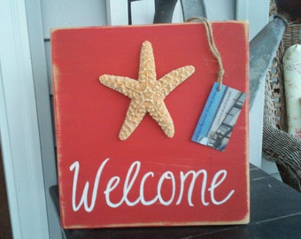 Red Wooden Welcome Sign with Starfish