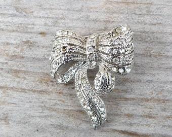 Vintage 1950  silvered metal  & rhinestones bow brooch