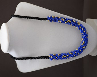 Cobalt blue and gold tone glass bead crochet rope necklace