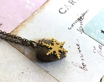 snowflake. heart locket necklace. in brass ox with etched lines locket
